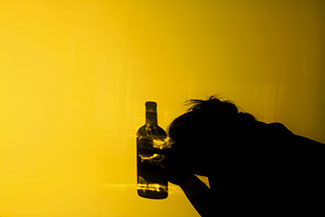 A woman contemplates her alcohol abuse and considers going to rehab