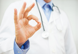 "A trained, medical addiction specialist gives the ""ok"" sign to an alcoholic who has found the best treatment option for themselves"