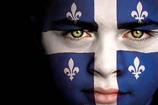 Man who's face is painted with the Quebec flag, ponders Quebec's approach to alcohol abuse treatment.
